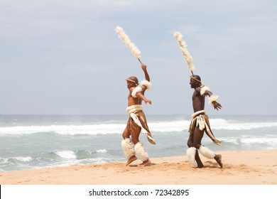 african zulu man dancing on beach