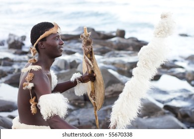 african zulu man on beach
