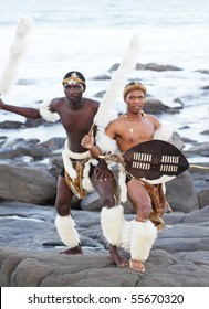 african zulu man posing on beach