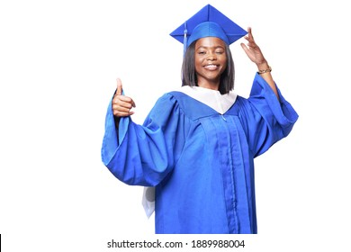 African-American beautiful woman in a blue robe and hat, on a white isolated background smiles, winks and shows thumb up