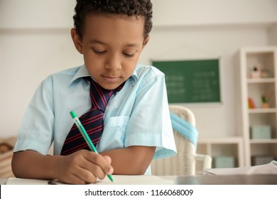 African-American boy doing exercise in classroom