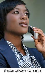 African-american Business woman outdoors talking on cell phone