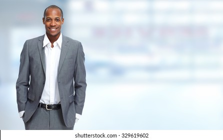 African-American Businessman over blue banner background
