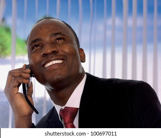 An african-american businessman talking on the phone