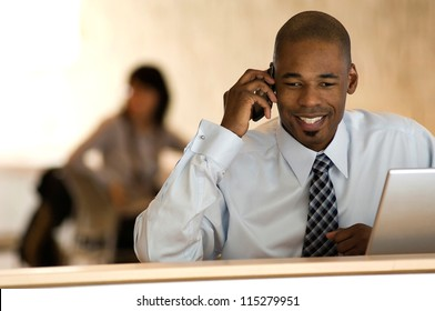 African-american businessman talking on phone in office