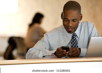 African-american businessman working at desk in office