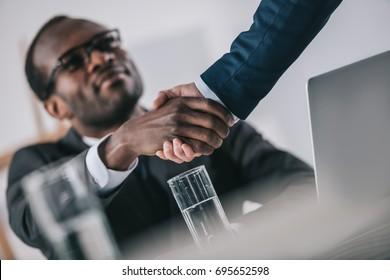 african-american businessmen shaking hand