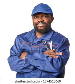 African-American car mechanic on white background
