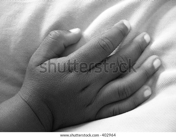 African-American child's hand.