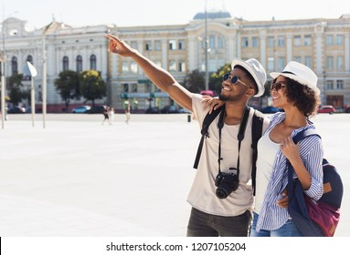 African-american couple of tourists sightseeing in city, copy space