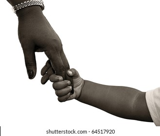 African-American family: child is holding mothers hand - black and white