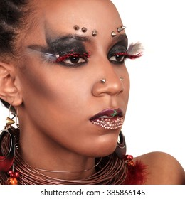 African-american fashion style. Young beautiful African fashion model with traditional bijou. Portrait of ethnic fashionable woman wearing jewelery. Latin woman with evening makeup and hairstyle.