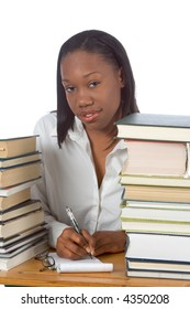 African-American female by piles of books