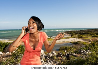 african-american female happy and talking on a cellphone