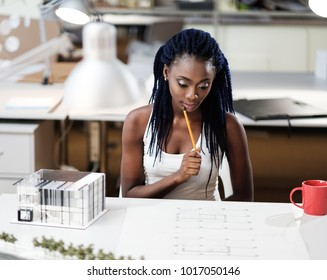 African-american girl in design and engineering architecture office.
