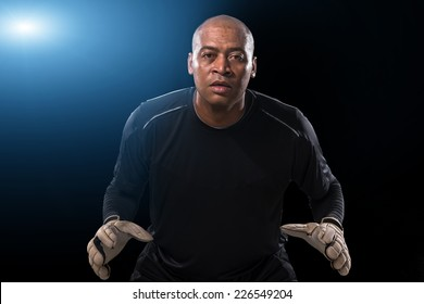 African-American goalkeeper is ready to catch the ball