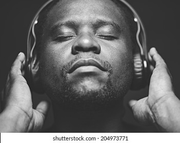 African-American guy with headphones listening to his favourite music