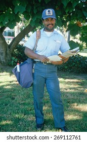 An African-American mail carrier on his route, Santa Monica, CA