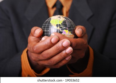 African-American male hands cradling a globe.