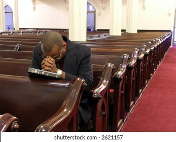 African-American man praying alone.