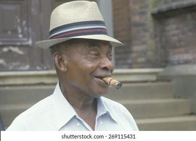 An African-American man smoking a cigar, Vicksburg, MS