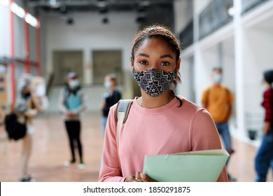 African-american student with face mask back at college or university, coronavirus concept. - Shutterstock ID 1850291875