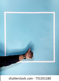 African-American Thumbs Up in Front of Blue Background Contained by Minimalistic Artistic White Square