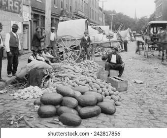 African-American vendors selling farm produce at the Sixth Street market, Richmond, Virginia.
