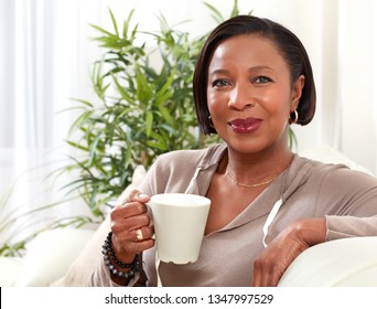 African-American woman drinking tea.