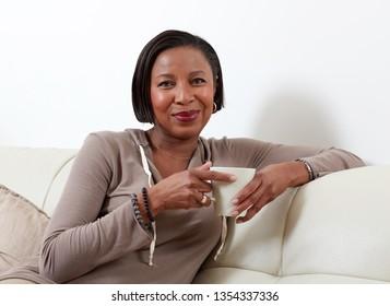 African-American woman drinking tea.