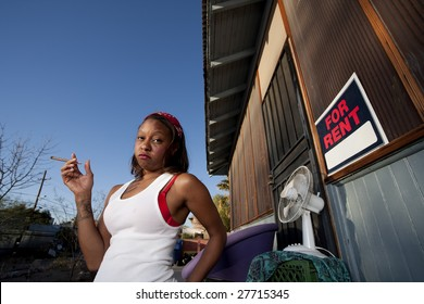 African-American woman in front of rental house