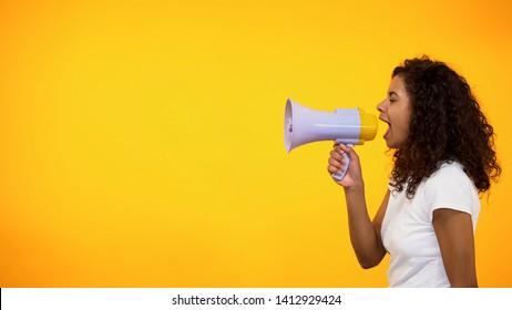 African-American woman with megaphone announcing sensation news, shop discounts