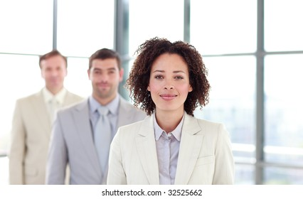 African-American young businesswoman in a line with her colleagues