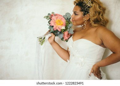 African-faced bride in a white dress