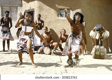 Africans dancing in a local village in Port Elizabeth, South Africa dancing and playing for tourists 11 April 2014