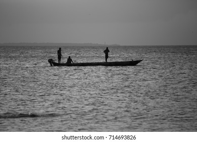 Africans people are traveling by boat to the coast