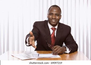 Africsn american businessman stretching his arm