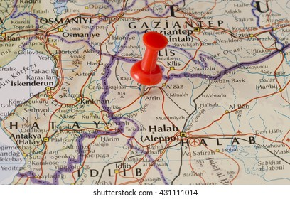 Afrin marked on map with red pushpin. Selective focus on the word Afrin and the pushpin. Pin is in an angle. Midground is sharp while foreground and background is blurry.