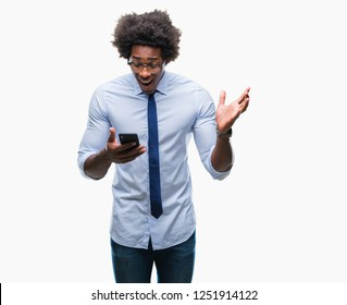 Afro american business man texting using smartphone over isolated background very happy and excited, winner expression celebrating victory screaming with big smile and raised hands