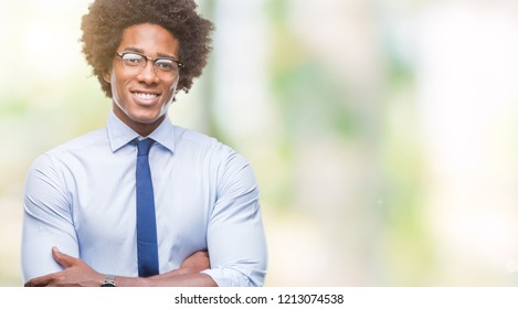 Afro american business man wearing glasses over isolated background happy face smiling with crossed arms looking at the camera. Positive person.
