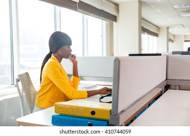 Afro american businesswoman working in office