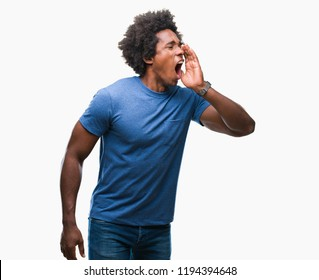 Afro american man over isolated background shouting and screaming loud to side with hand on mouth. Communication concept.
