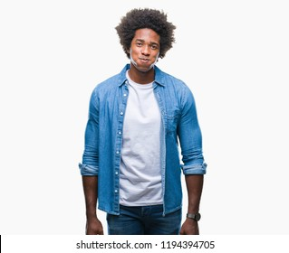 Afro american man over isolated background puffing cheeks with funny face. Mouth inflated with air, crazy expression.