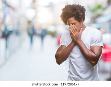 Afro american man over isolated background with sad expression covering face with hands while crying. Depression concept.