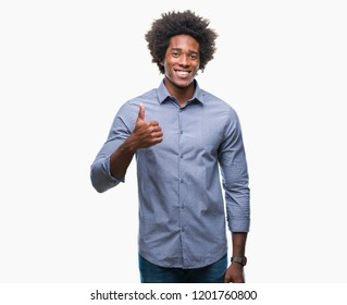 Afro american man over isolated background doing happy thumbs up gesture with hand. Approving expression looking at the camera with showing success.