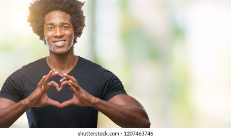 Afro american man over isolated background smiling in love showing heart symbol and shape with hands. Romantic concept.