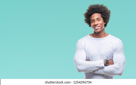 Afro american man over isolated background happy face smiling with crossed arms looking at the camera. Positive person.