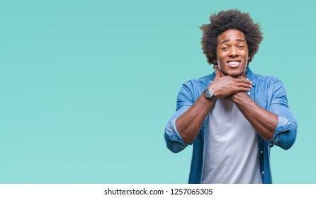 Afro american man over isolated background shouting and suffocate because painful strangle. Health problem. Asphyxiate and suicide concept.