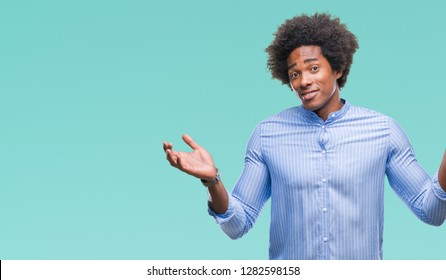 Afro american man over isolated background clueless and confused expression with arms and hands raised. Doubt concept.