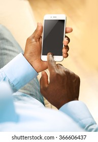Afro american man with a smartphone indoor